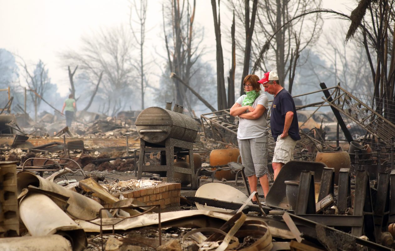 Bruce and Lisa Coats look over the remains of their home in the Coffey Park subdivision of Santa Rosa, Calif., Oct. 9, 2017. (Jim Wilson/New York Times)