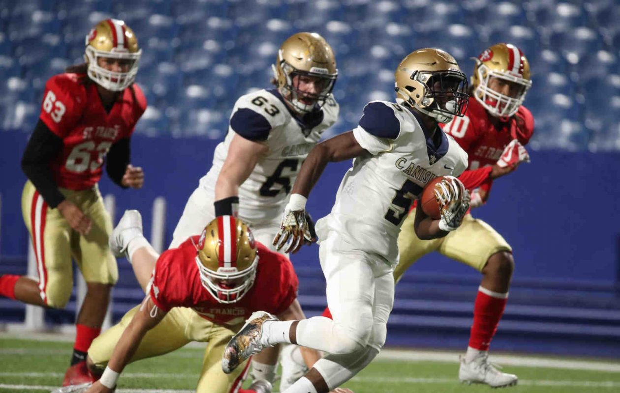 Canisius' Joe Jamison runs for a 75-yard touchdown on the first play of the game in a 39-9 win over St. Francis on Thursday. (James P. McCoy/Buffalo News)