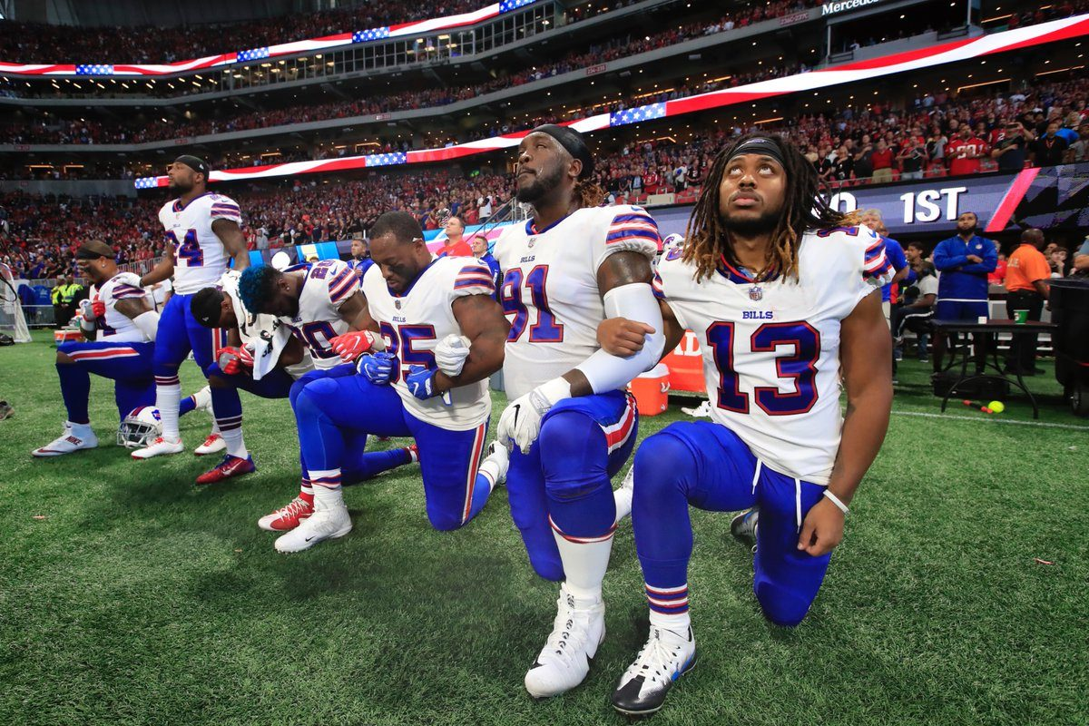 Six members of the Buffalo Bills opted to take a knee during the playing of the national anthem Sunday. (Harry Scull Jr./Buffalo News)