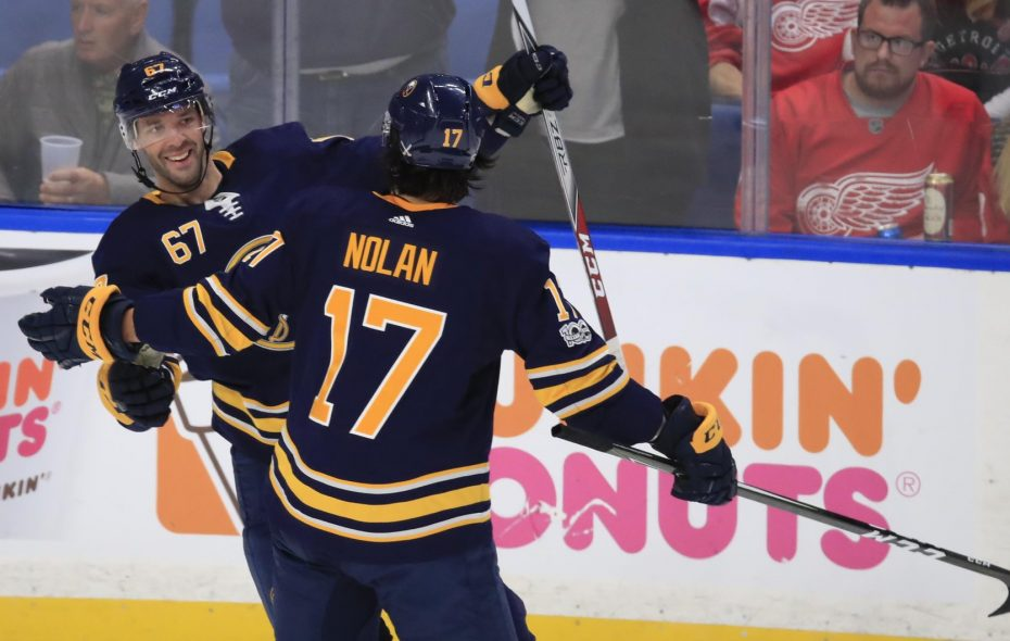 The Sabres' Jordan Nolan, playing in his 300th NHL game, congratulates Benoit Pouliot on his second goal of the season. (Harry Scull Jr./Buffalo News)