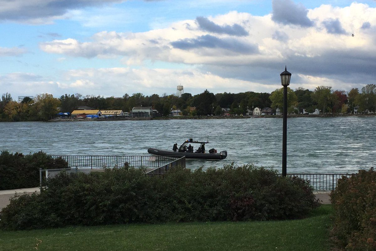 A Niagara Regional Police  boat in the Niagara River just off the wall near Broderick Park Tuesday as search for missing Buffalo police diver Craig Lehner enters its fifth day. (Aaron Besecker/Buffalo News)