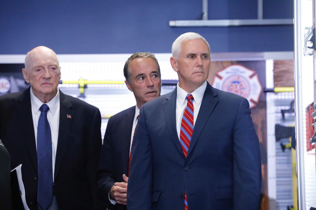 Dick Young, founder of Performance Advantage Co., left, shows Rep.   Chris Collins and Vice President Pence the showroom in Lancaster. (Derek Gee/Buffalo News)