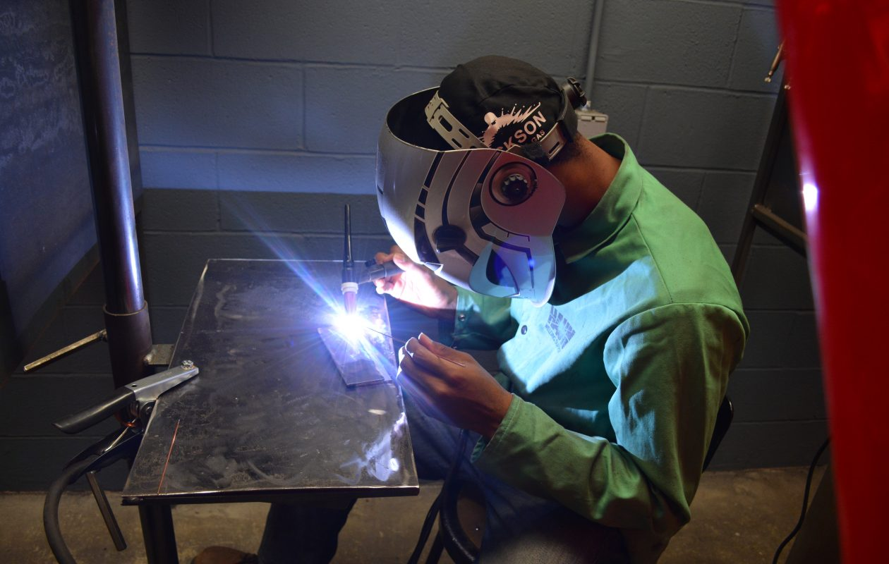 Amherst senior Bryce Banks works in one of the new welding booths in the Erie 1 BOCES Kenton Career and Technical Center welding lab