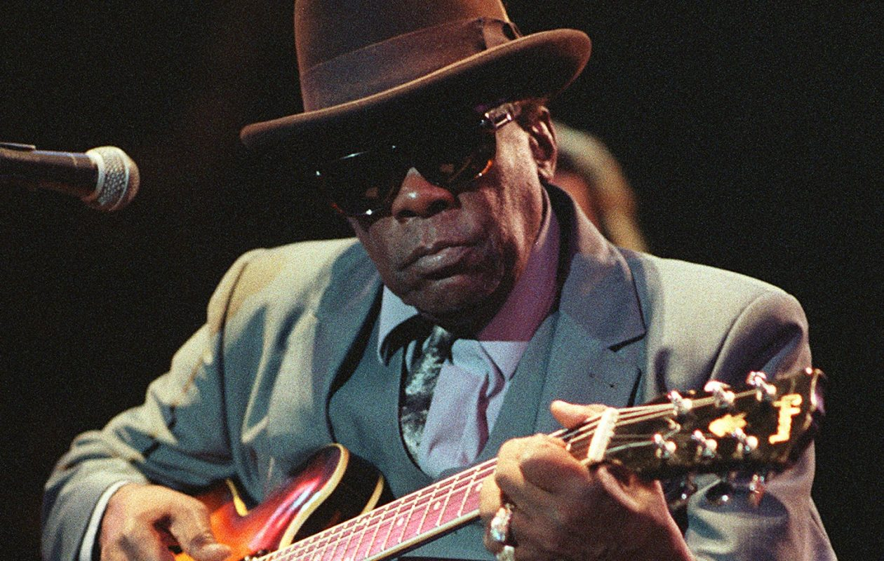 John Lee Hooker, pictured performing at a concert in Paris in 1990. (Bertrand Guay/Getty Images)