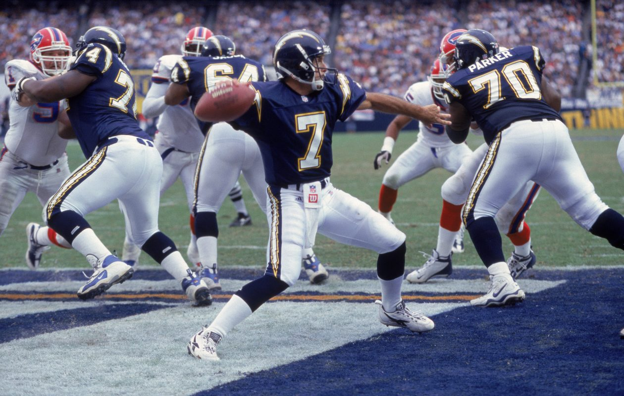 Vaughn Parker (70) blocks for San Diego QB Doug Flutie in a game against the Bills in 2001. (Getty Images)
