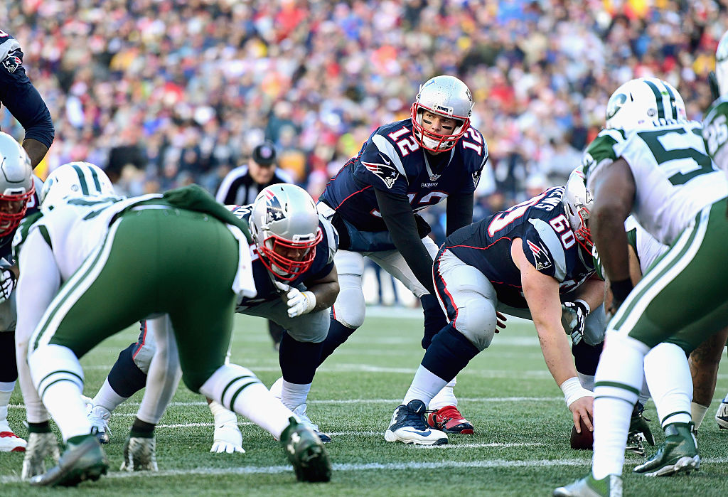 Tom Brady #12 of the New England Patriots prepares to take a snap during the third quarter of a game against the New York Jets at Gillette Stadium on December 24, 2016 in Foxboro, Massachusetts.  (Photo by Billie Weiss/Getty Images)