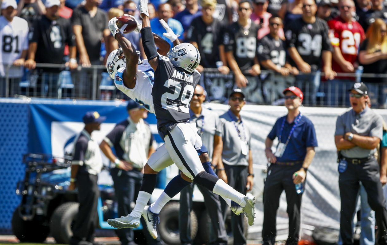 Raiders cornerback David Amerson attempts to defend a pass against the Titans (Photo by Wesley Hitt/Getty Images) )