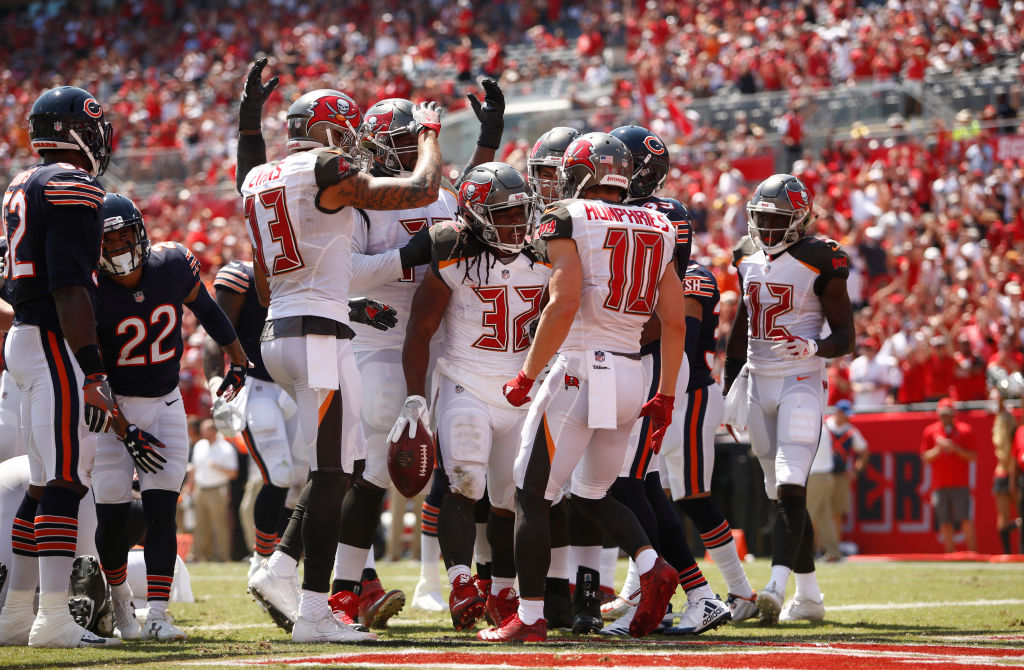 Running back Jacquizz Rodgers #32 of the Tampa Bay Buccaneers celebrates with teammates in the end zone after a 1-yard rush for a touchdown against the Chicago Bears. (Photo by Brian Blanco/Getty Images)