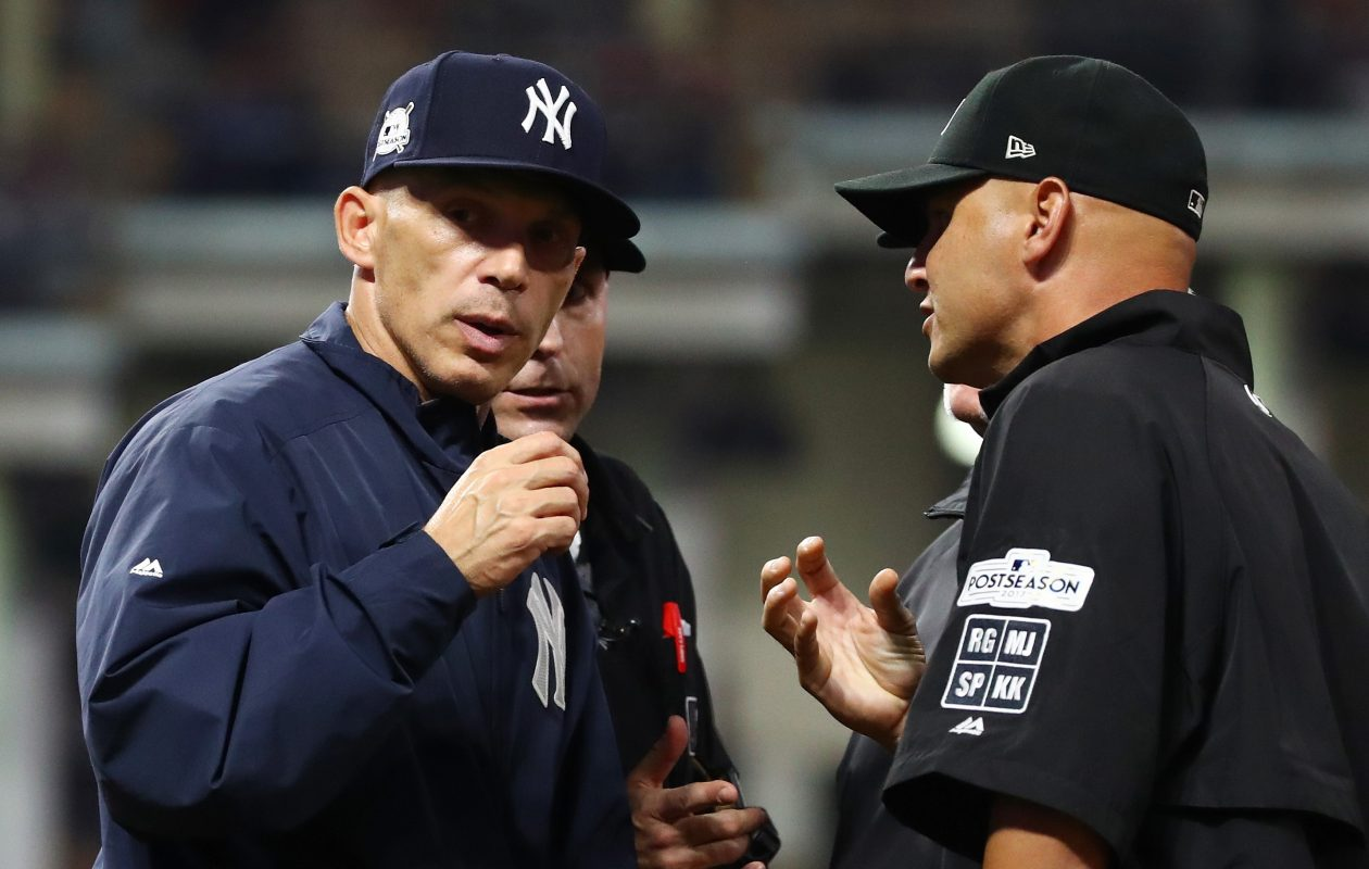 CLEVELAND, OH - OCTOBER 06:  Joe Girardi #28 of the New York Yankees argues a call in the tenth inning against the Cleveland Indians during game two of the American League Division Series at Progressive Field on October 6, 2017 in Cleveland, Ohio.  (Photo by Gregory Shamus/Getty Images)