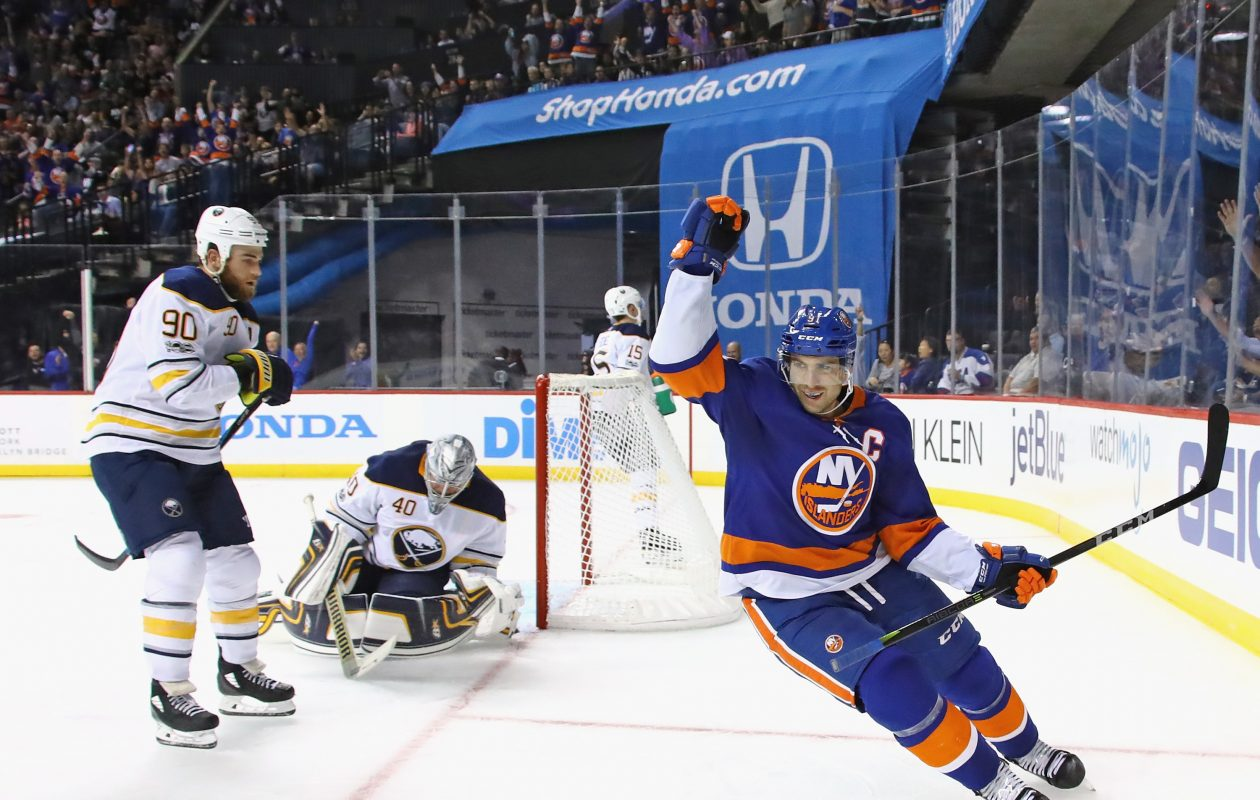 John Tavares celebrates the Islanders' first of two short-handed goals in front of Ryan O'Reilly (90), Robin Lehner (40) and Jack Eichel. (Getty Images)
