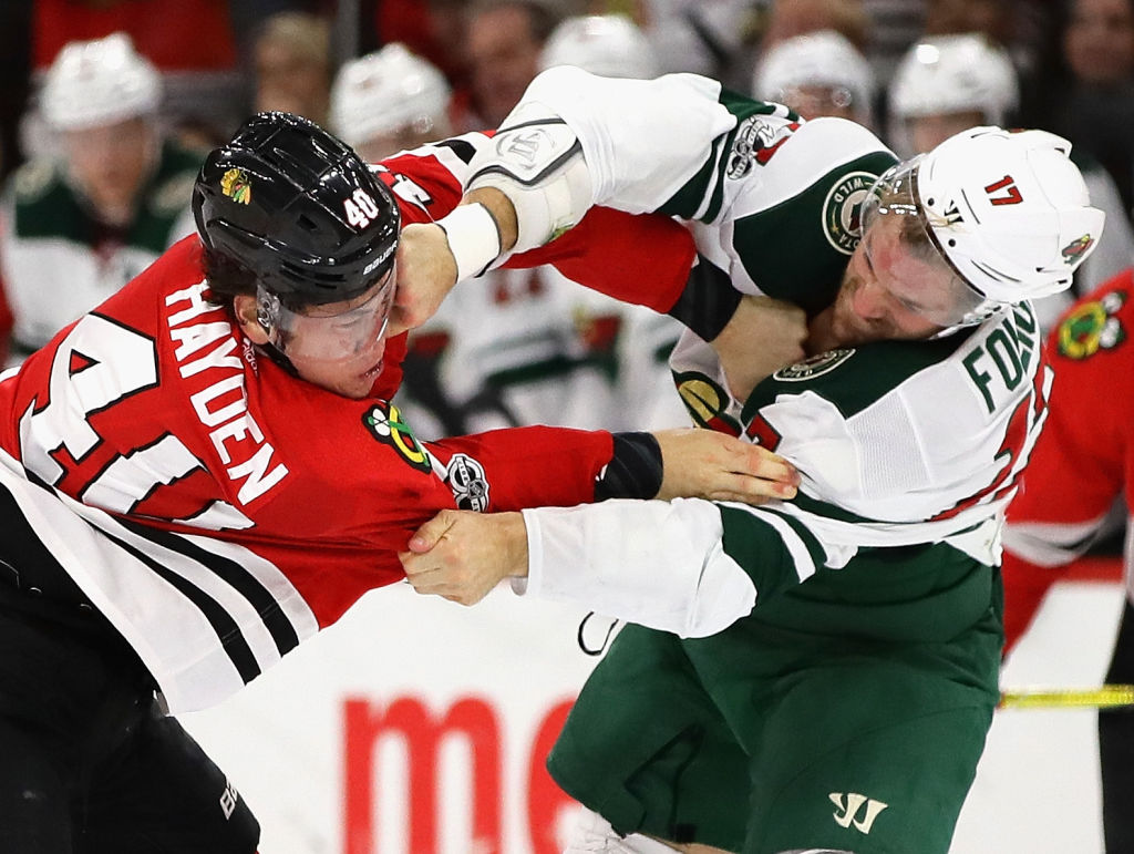 John Hayden of the Chicago Blackhawks and Marcus Foligno of the Minnesota Wild fight in the second period at the United Center on Oct. 12, 2017, in Chicago. (Getty Images)