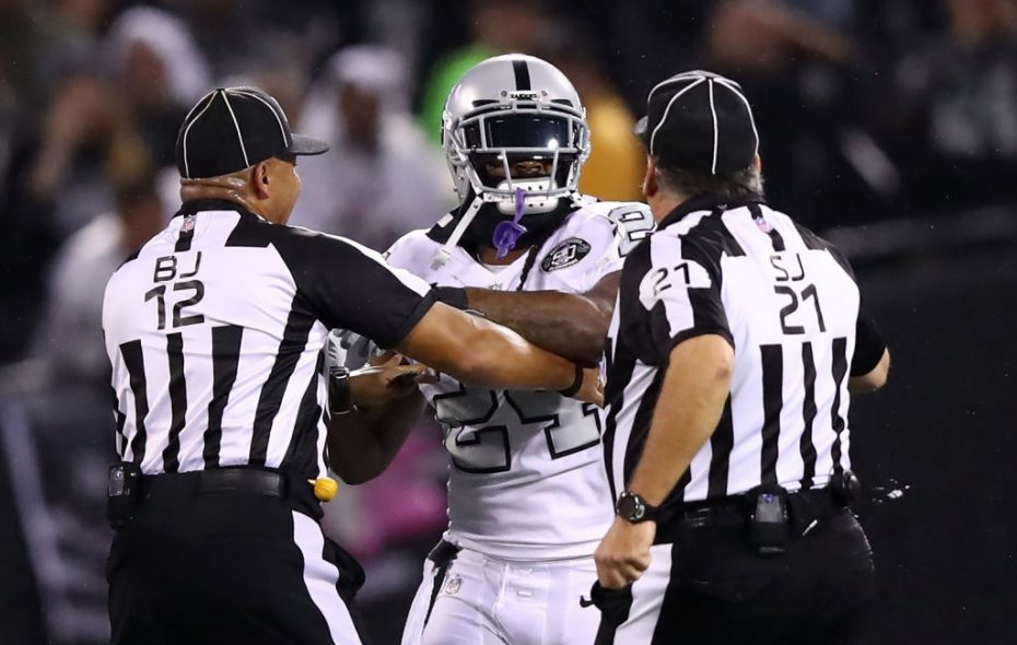 OAKLAND, CA - OCTOBER 19:  Marshawn Lynch #24 of the Oakland Raiders is restrained after coming off the bench and shoving a referee during a scrum with the Kansas City Chiefs in their NFL game at Oakland-Alameda County Coliseum on October 19, 2017 in Oakland, California. Lynch was ejected for unsportsmanlike conduct.  (Photo by Ezra Shaw/Getty Images)