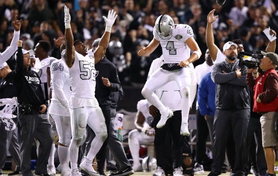 Khalil Mack and Derek Carr of the Oakland Raiders celebrate after the Michael Crabtree touchdown is confirmed by officials to tie their game 30-30 with the Kansas City Chiefs with no time left on the clock. The Raiders would go on to win. (Getty Images)
