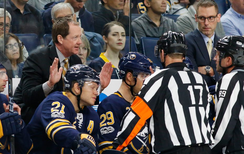 Sabres coach Phil Housley argues with referee Frederick L'Ecuyer after not getting his desired ruling on a coach's challenge. (Getty Images)