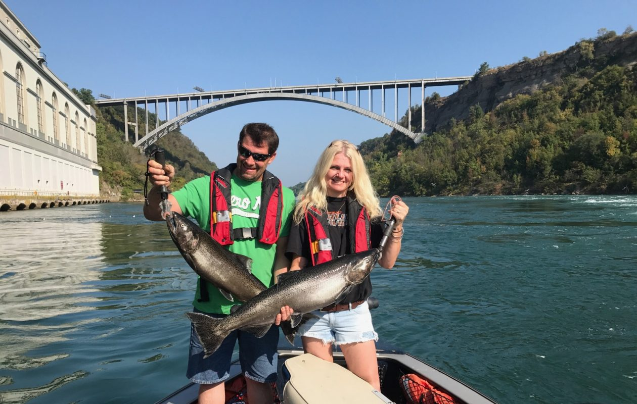 A doubleheader of salmon for this couple, fishing with Capt. Lloyd Schrack of Ameri-Can Charters.