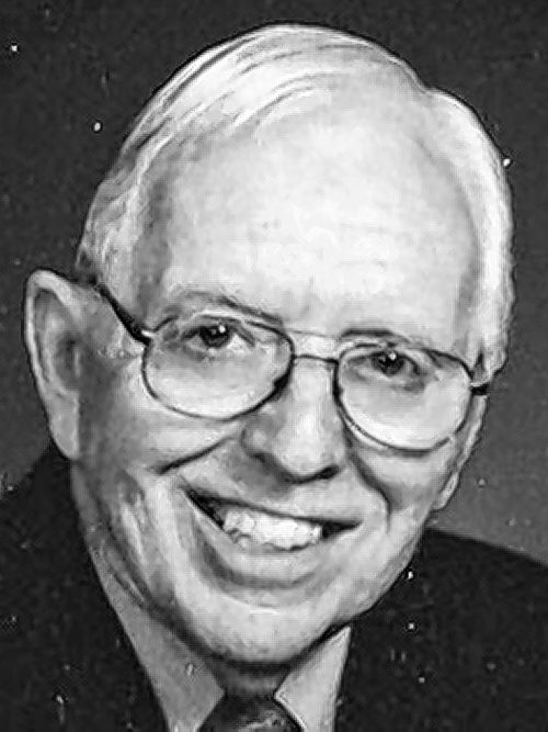 NELLIS, William F.