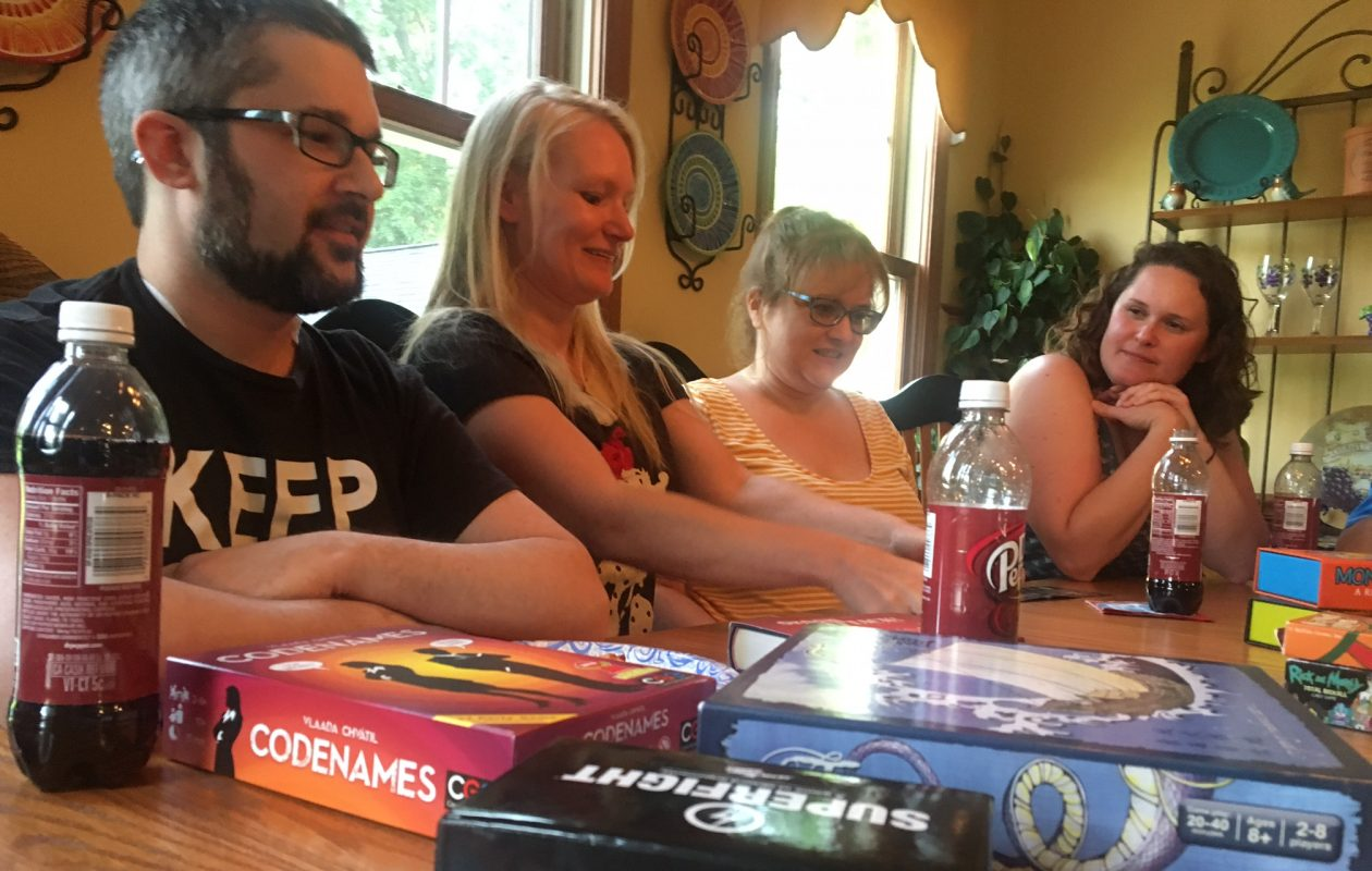 From left, 'Invisible' Illness Game Night Meetup Group members Ryan Gurnett, Jennifer Offhaus, Christy Kassler and Aubrey Pitzi recently gathered at Gurnett's Hamburg home for a special night of game-playing. (Photo by Scott Scanlon)