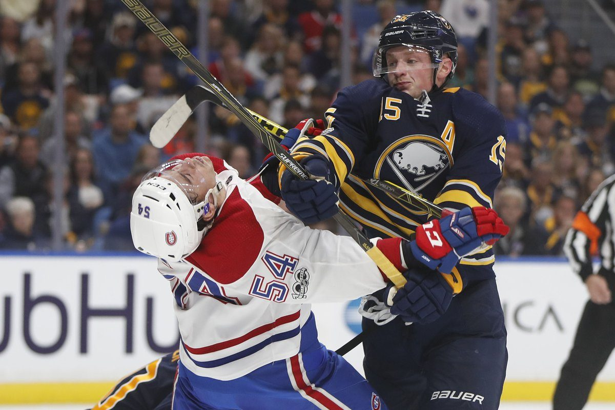 Jack Eichel gets physical with Montreal's Charles Hudon in the second period (Mark Mulville/Buffalo News).