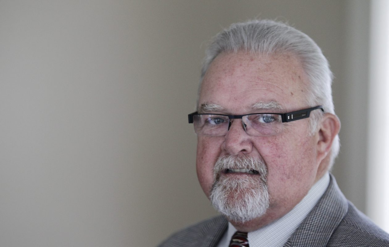 James Allen, the former executive director of the Amherst Industrial Development Agency, from a 2012 photo in his IDA office. {File photo by Harry Scull Jr. / The Buffalo News}