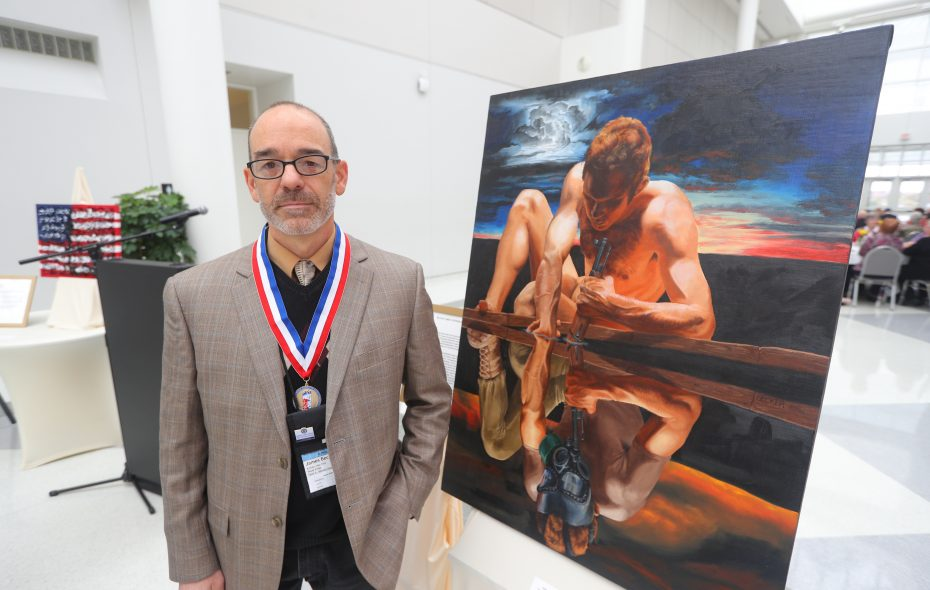 James Becker and his painting Intraflection at the National Veterans Creative Arts Festival at UB Center for the Arts in Amherst  on Saturday, Oct. 28, 2017.  (John Hickey/Buffalo News)