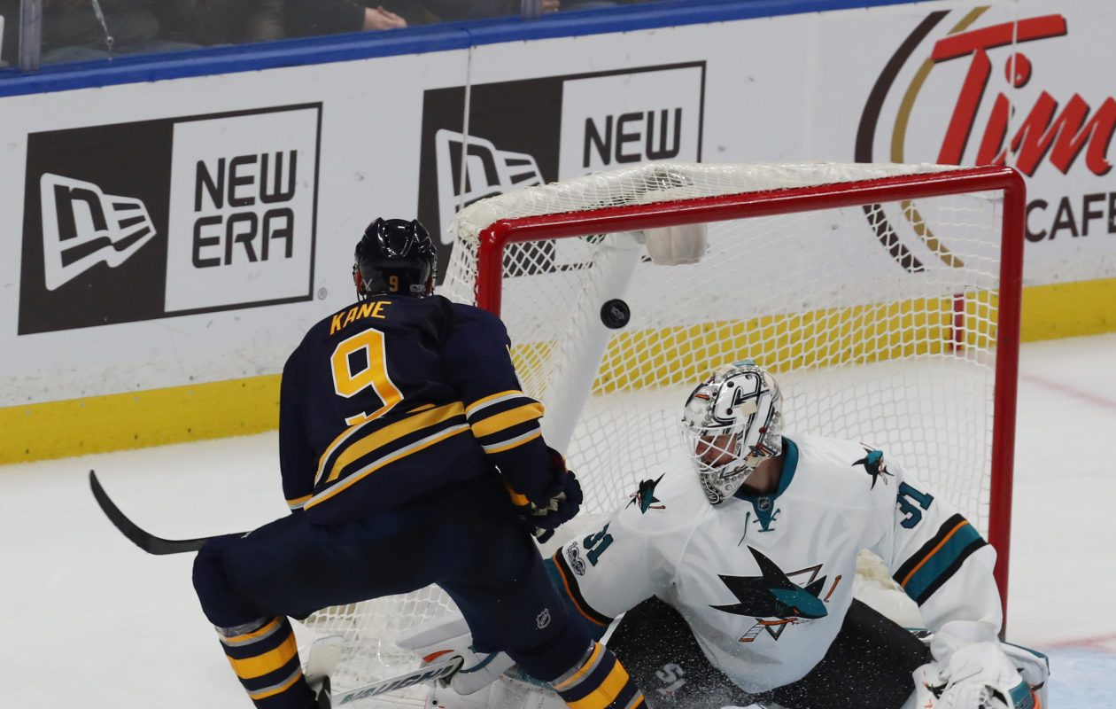 Evander Kane beats San Jose goalie Martin Jones to give the Sabres a 5-4 overtime win over the Sharks on Feb. 7. (James P. McCoy/News file photo).