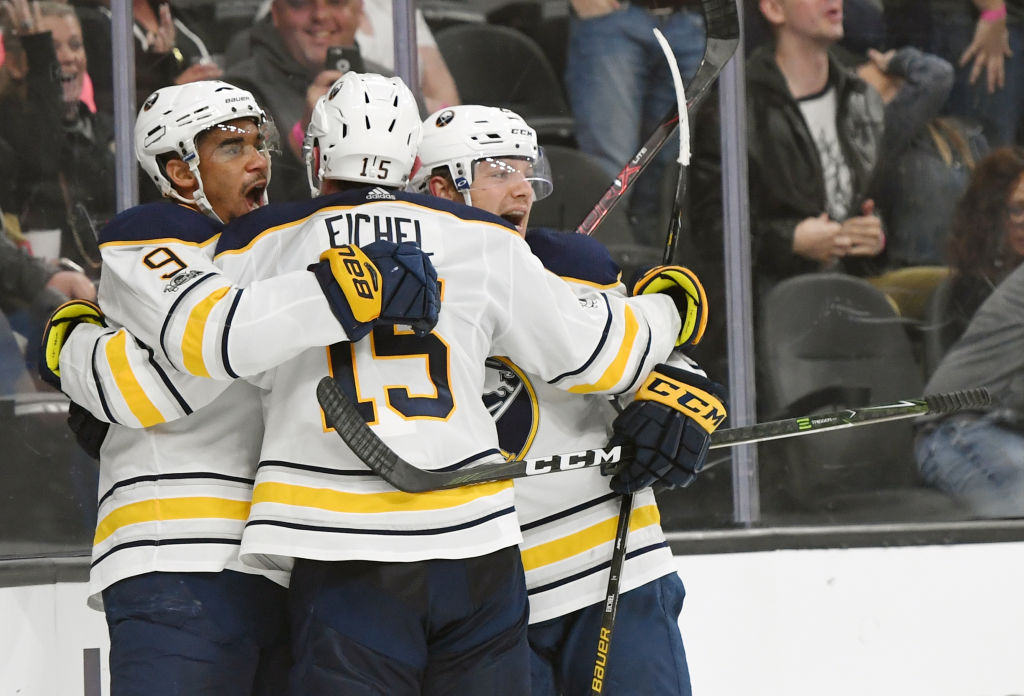 Evander Kane (9) celebrates his game-tying goal with 8.9 seconds  left along with Jack Eichel and Sam Reinhart (Getty Images).
