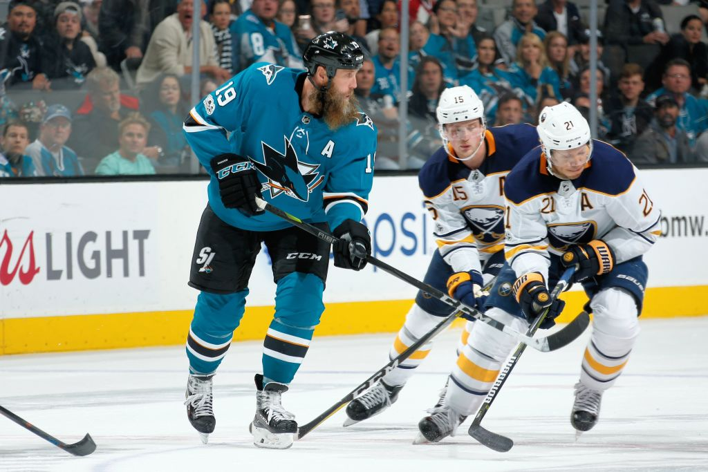 Kyle Okposo (21) and Jack Eichel battled San Jose's Joe Thornton Thursday night, but Okposo won't play Saturday in Los Angeles. (Getty Images)
