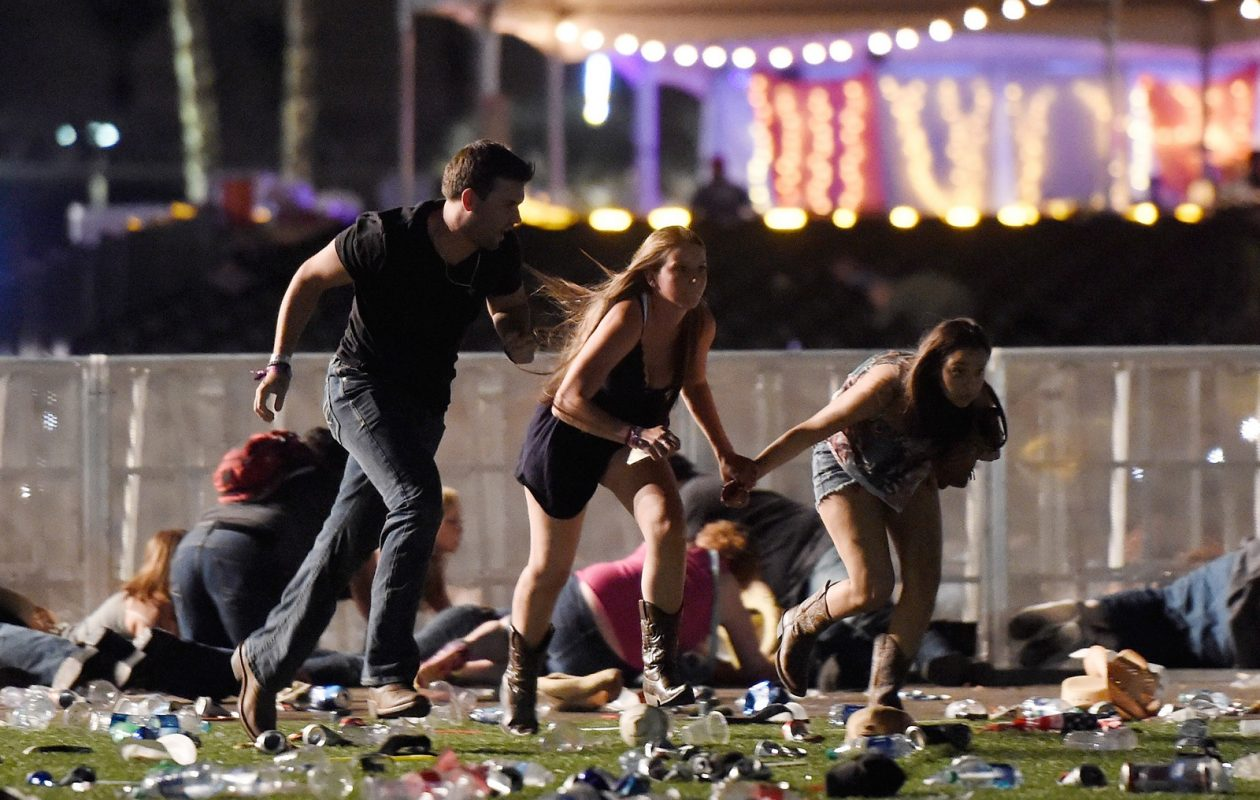 Concertgoers flee the Route 91 Harvest country music festival in Las Vegas on Sunday, as a sniper fires from adjacent Mandalay Bay Hotel. (Getty Images)