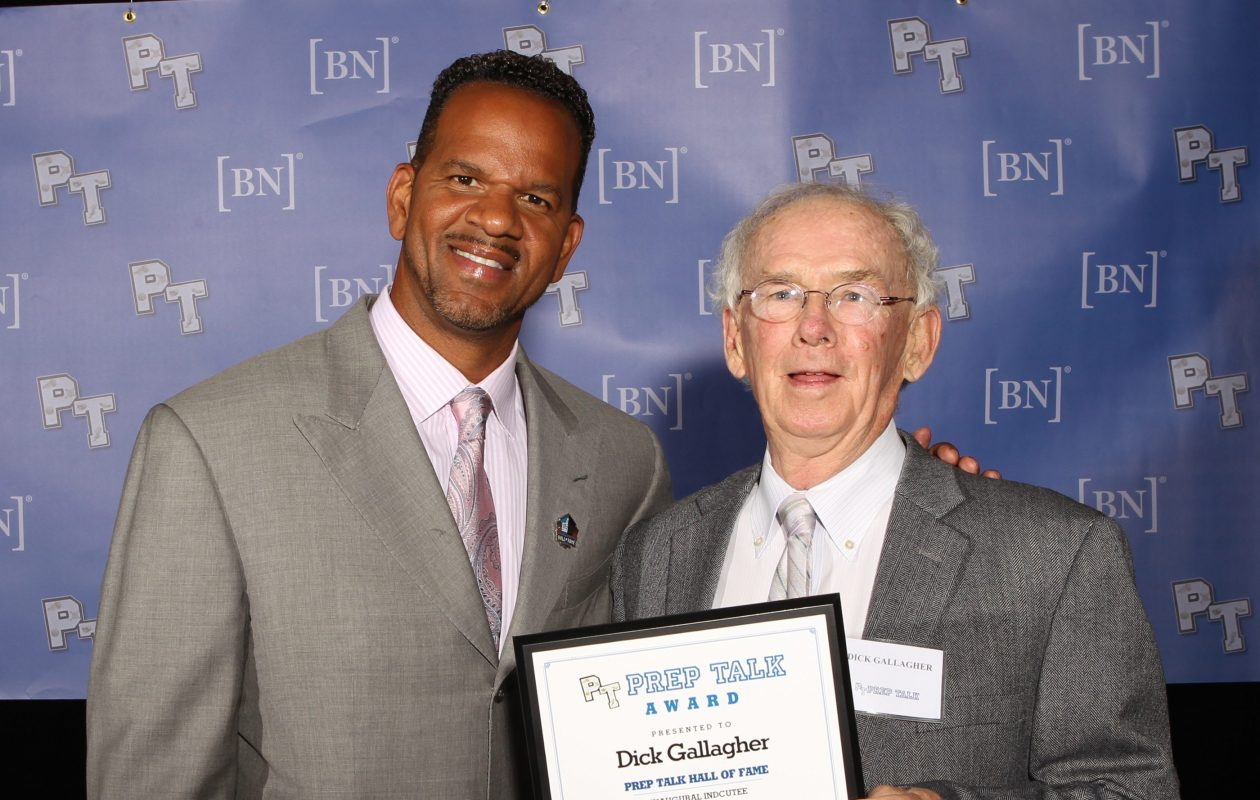 Dick Gallagher, right, poses with Andre Reed after being inducted into the Buffalo News Prep Talk Awards Hall of Fame in 2014. (James P. McCoy/Buffalo News file photo)