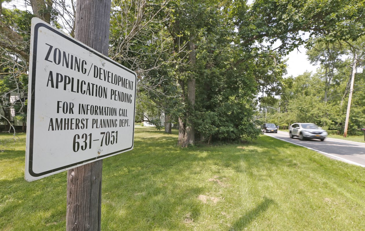 A sign near the location where Natale Builders propose to build 80 houses on New Road in Amherst.  (Robert Kirkham/Buffalo News)