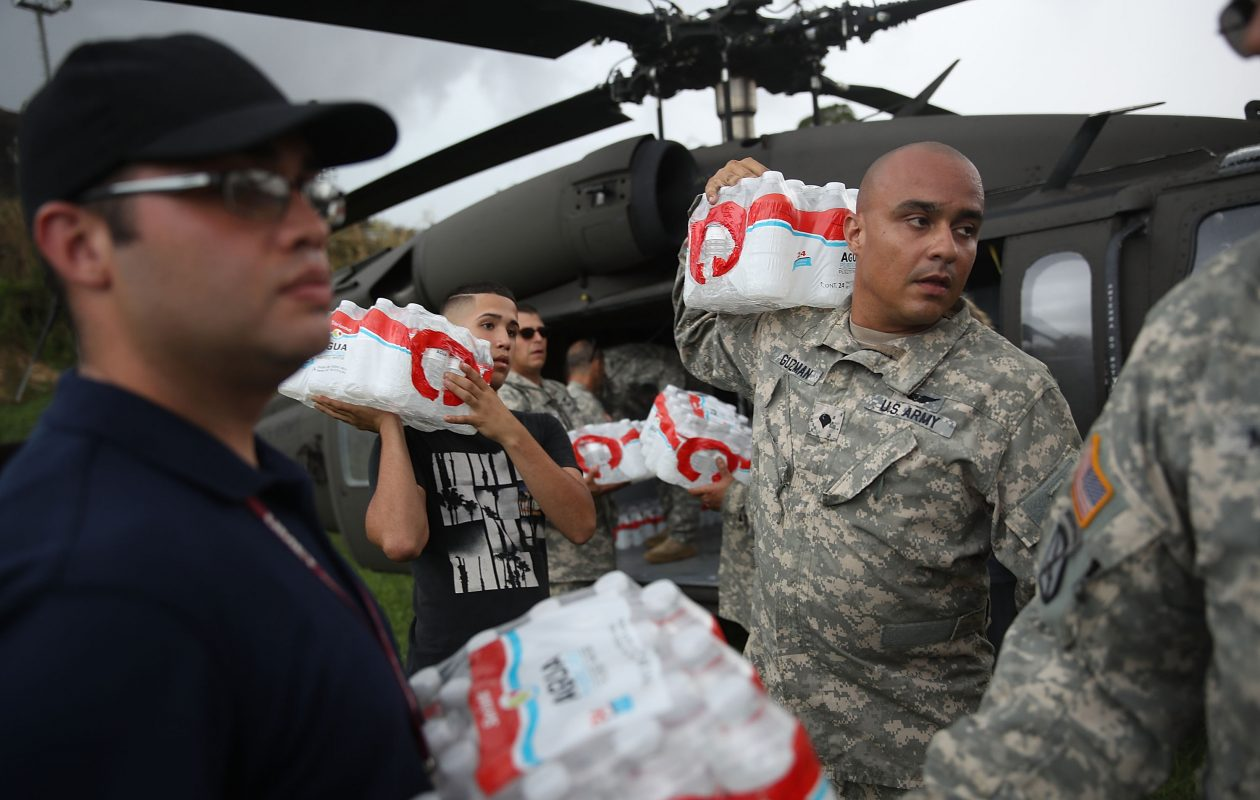 Members of the Puerto Rican National Guard deliver food and water via helicopter to hurricane survivors as they deal with the aftermath of Hurricane Maria on September 29, 2017 in Lares, Puerto Rico.  (Photo by Joe Raedle/Getty Images) *** BESTPIX ***