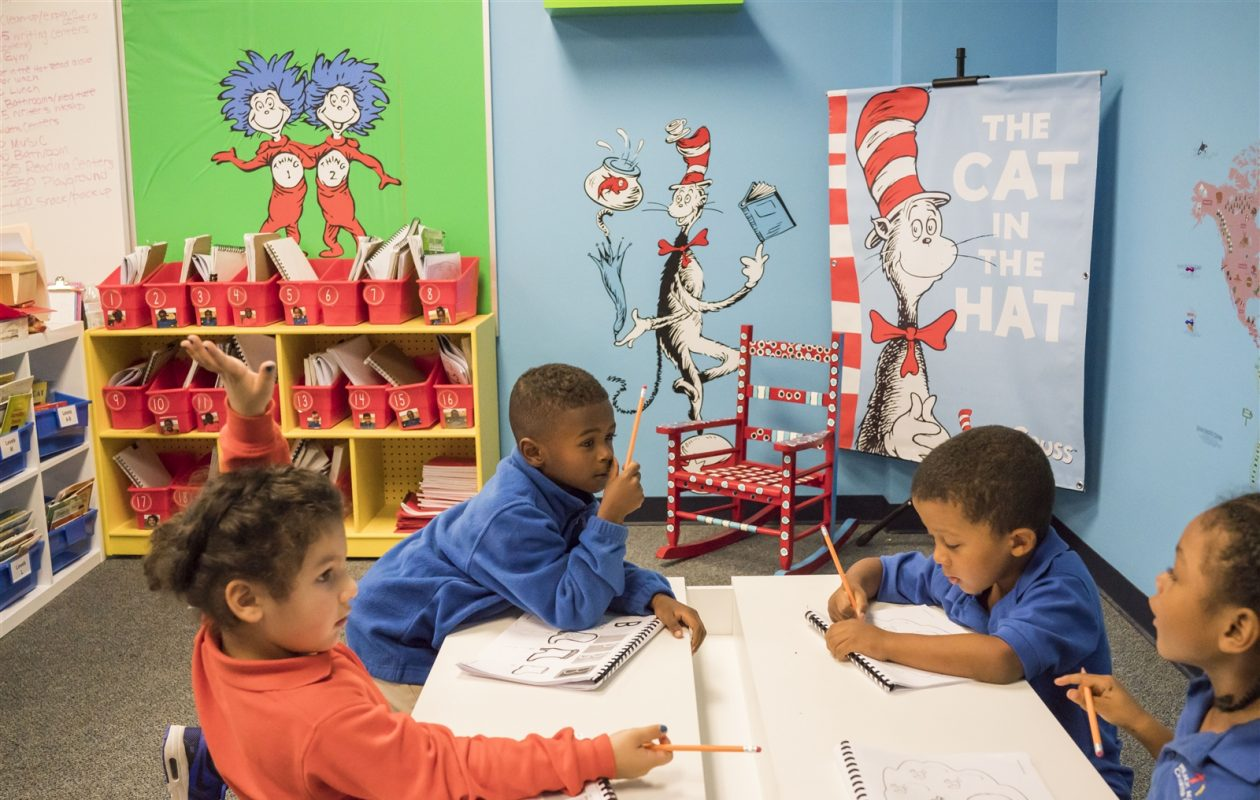 Kindergartners work on a class exercise in the Dr. Seuss room at REACH Academy Charter School, which opened this year. (Derek Gee/Buffalo News)