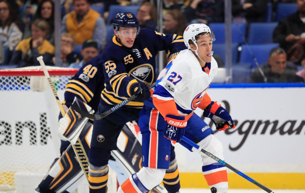 Rasmus Ristolainen works against Anders Lee of the Islanders Friday night (Harry Scull Jr./Buffalo News).