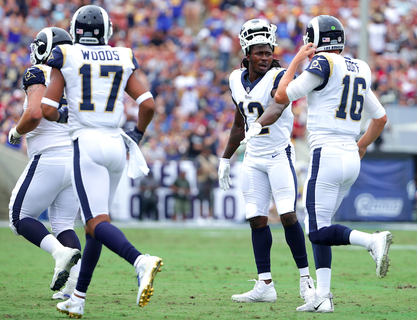 Sammy Watkins talks with Rams QB Jared Goff on the way off the field (Getty Images)