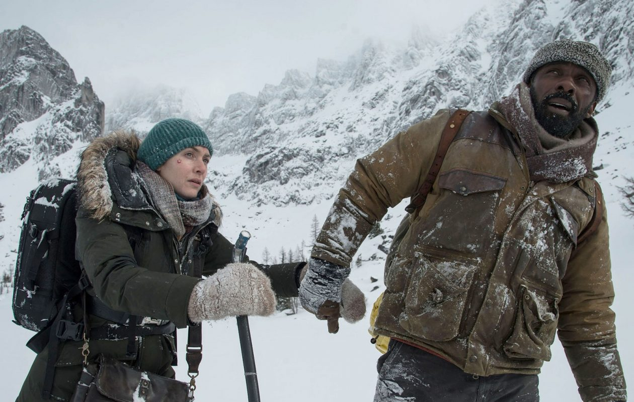 Kate Winslet, left, and Idris Elba play survivors of a plane crash in the romantic thriller 'The Mountain Between Us.' (Kimberley French, Twentieth Century Fox)
