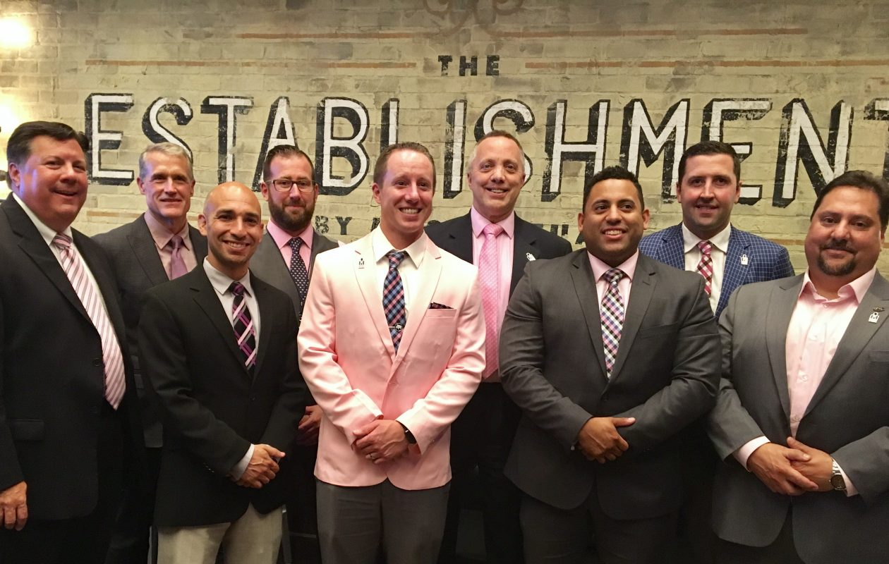 Joe Cantafio, first row at right, is joined by other Buffalo area civic leaders in this month's Real Men Wear Pink fundraiser for the American Cancer Society's regional chapter.  The others are, from first row, left, Dr. Richard Vienne, vice president and chief medical officer with Univera Healthcare; Michael Crisona, executive director of the regional cancer society chapter; Chris Koenig, president and CEO of Niagara Lutheran Health System and The GreenFields; and Wesley King, business banking express underwriter with M&T Bank; and back row, from left, Dr. Thomas Foels, executive vice president and chief medical officer with Independent Health; Robbert Duggan, vice president and chief operating officer with  American Coradius International; Dr. Kenneth Macur, president of Medaille College; and Trevor Large, hockey coach at Canisius College. (Photo courtesy of the American Cancer Society)