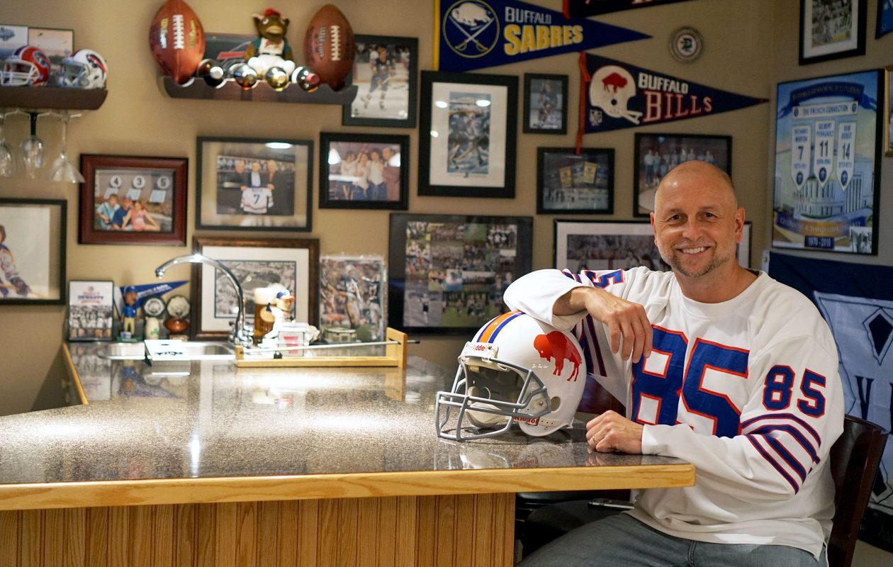 """When Tim Tryjanowski built his Clarence home,  he made his basement """"as bulletproof as possible""""  in anticipation of creating a space to store and display his lifelong collection of sports memorabilia. (Dave Jarosz)"""