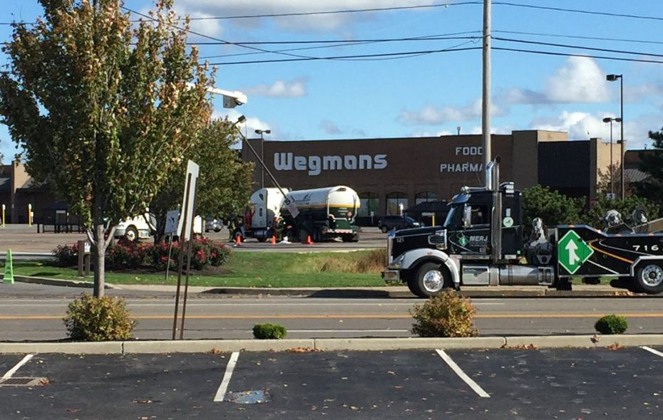 Many personnel have been moved back across Military Road as crews prepare to move trailer without causing a new leak of refrigerated hydrogen. The tanker struck a pole Tuesday night in the Wegmans parking lot. (Aaron Besecker/Buffalo News)