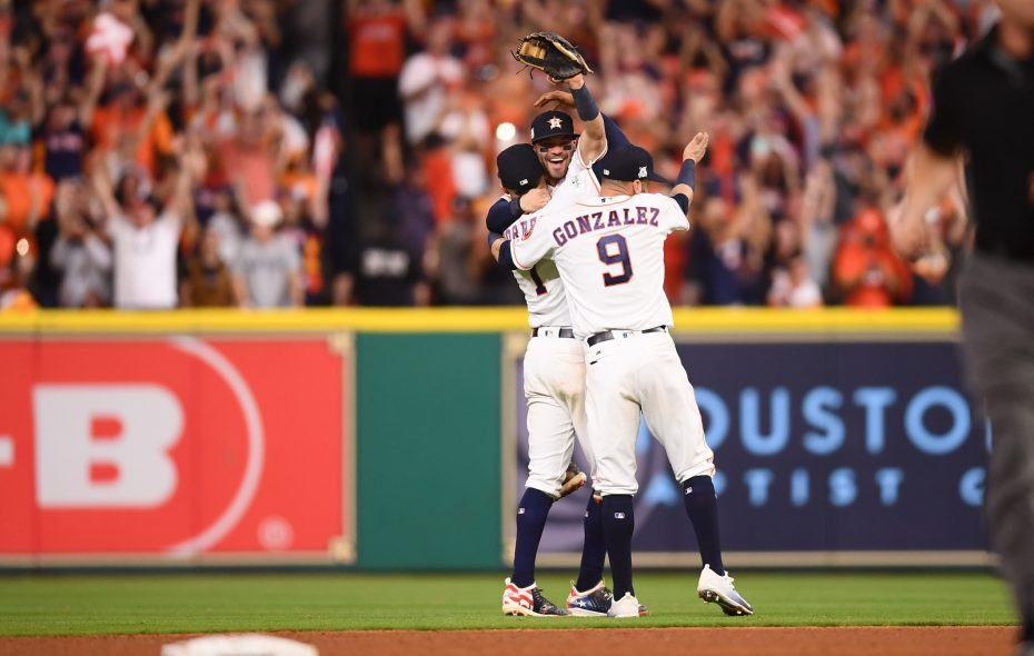 Jose Altuve, center, Carlos Correa and Marwin Gonzalez embrace after the Houston Astros won the pennant with a 4-0 win over the New York Yankees in Game 7 of the American League Championship Series. (Ben Solomon/New York Times)