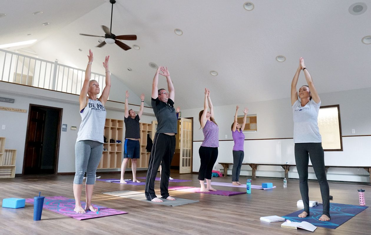 At the Fountain Wellness Center in Williamsville, Holy Yoga classes combine the health benefits of yoga with Christian scripture and songs. Pictured are instructor Teresa De Labio (far right) leading class members (from left): Brenda Wagner, Rob Anstey, Greg Lelonek, Tammy Prosser and Marianne Giancola. (Dave Jarosz)