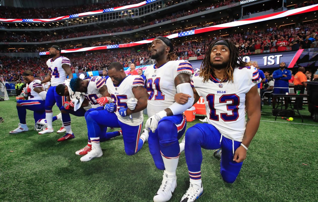 Six Buffalo Bills players kneel during the national anthem prior to the first half against the Atlanta Falcons at Mercedes-Benz Stadium on Oct. 1, 2017, in Atlanta. (Harry Scull Jr./Buffalo News)