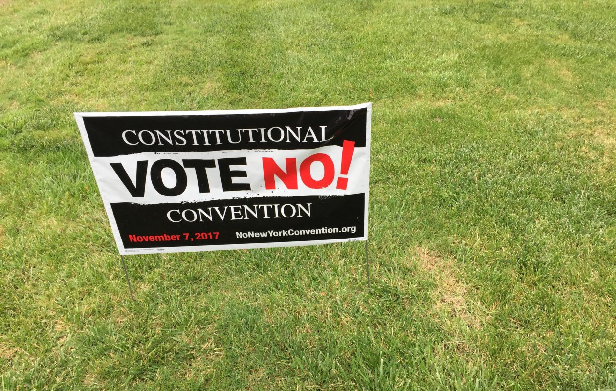 Signs like this one in a yard on East River Road on Grand Island are popping up all over Western New York. (Jean Westmoore/Buffalo News)