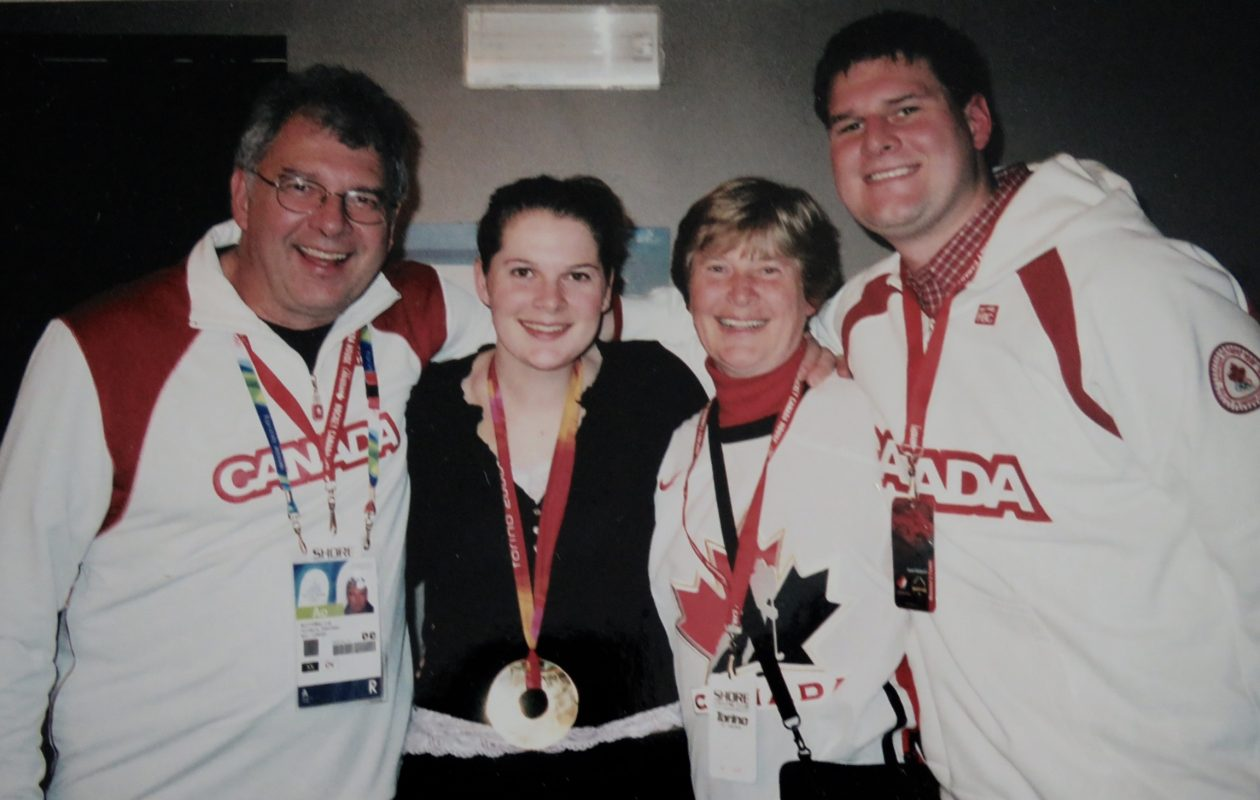 From left: Cal Botterill, Doreen Botterill and new Sabres GM Jason Botterill celebrate Jennifer Botterill's gold medal for Canada at the 2006 Olympics in Torino, Italy (Photo courtesy of Manitoba Sports Hall of Fame).