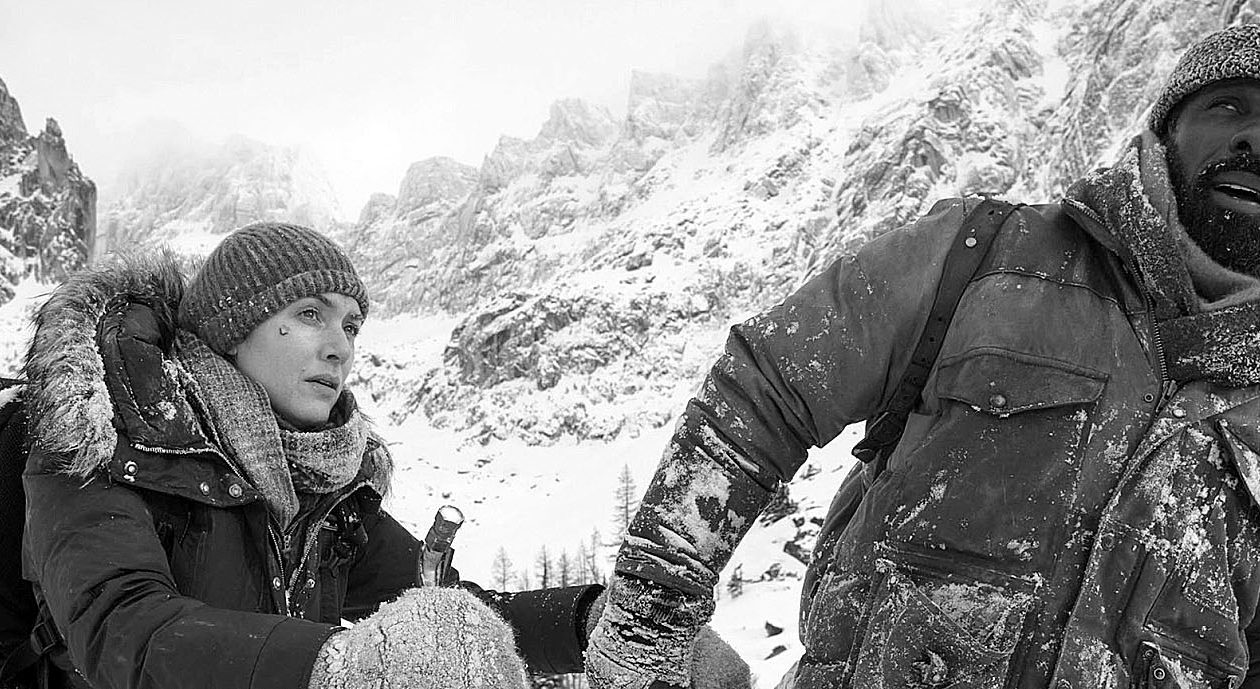 Kate Winslet, left, and Idris Elba play survivors of a plane crash in the romantic thriller 'The Mountain Between Us.'