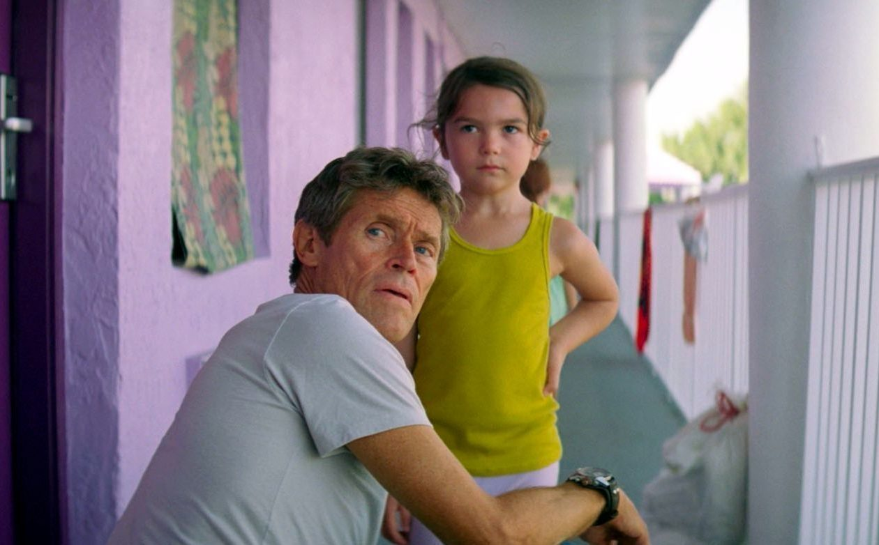 Willem Dafoe plays a kind-hearted hotel manager and Brooklynn Prince is one of the children he keeps an eye on in 'The Florida Project.'
