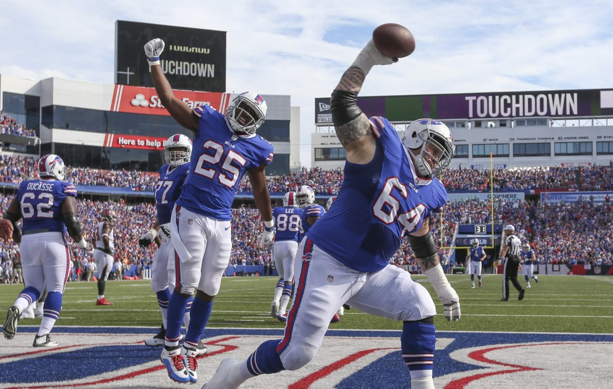 Buffalo guard Richie Incognito spikes the ball after running back LeSean McCoy rushed for a touchdown against Tampa Bay at New Era Field. (James P. McCoy/Buffalo News)