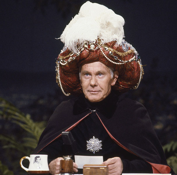 "Johnny Carson as ""Carnac The Magnificent"" (Photo by Chris Haston/NBCU Photo Bank)"