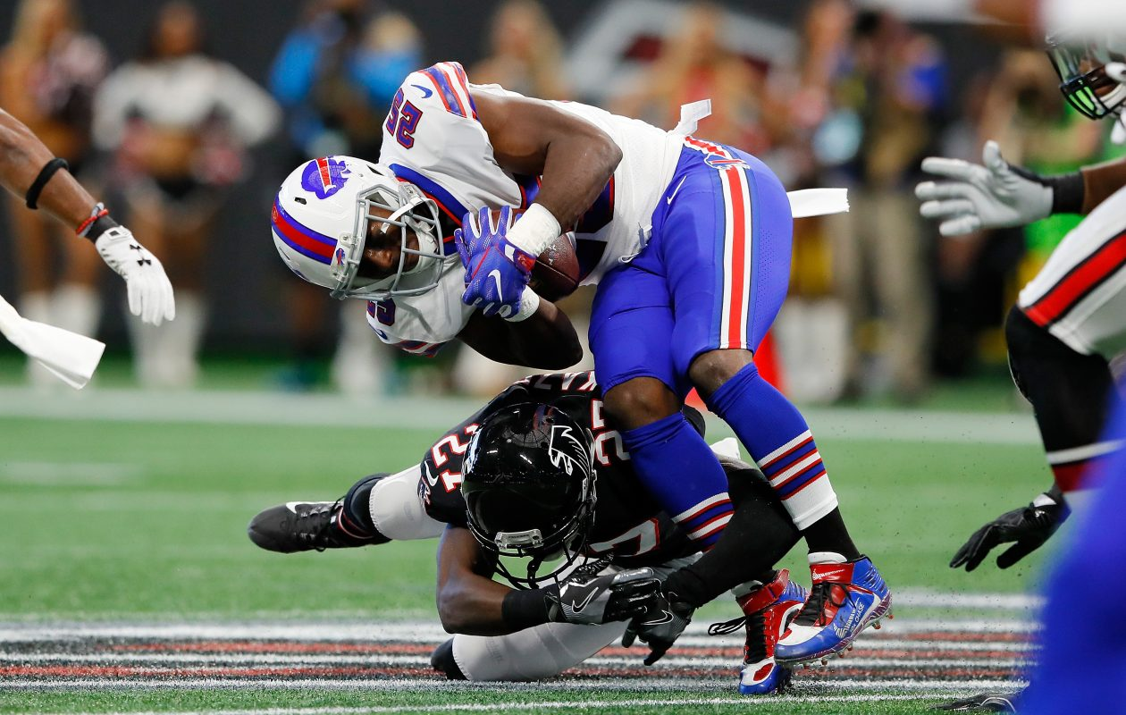 LeSean McCoy of the Buffalo Bills is tackled by Damontae Kazee of the Atlanta Falcons during the first half at Mercedes-Benz Stadium. (Kevin C.  Cox/Getty Images)