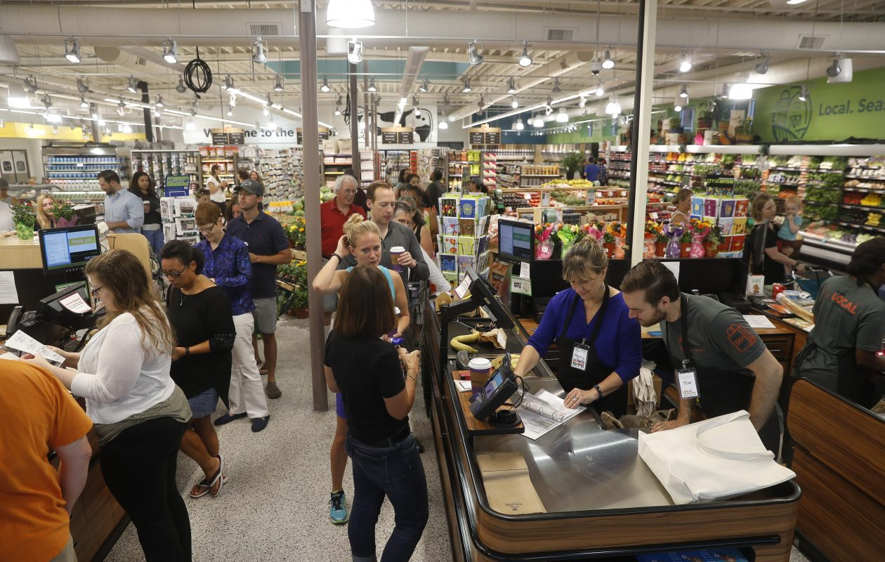 Shoppers check out at the Lexington Co-op's new location on Hertel Avenue on its opening day in July.  (John Hickey/Buffalo News)