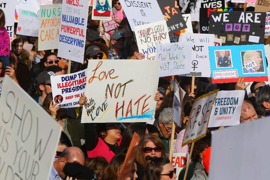 WNY Peace Center sponsored a women's rally in Niagara Square Saturday, January 21, 2017. (Mark Mulville/The Buffalo News)